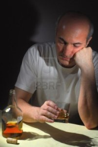 4981911-extreme-close-up-image-of-drunk-man-holding-a-glass-of-whiskey